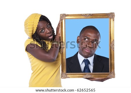 young african woman holding a portrait of a businessman with a funny expression (isolated on white) - stock photo