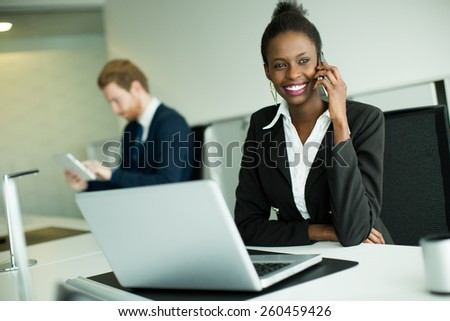 Young african woman in the o0ffice