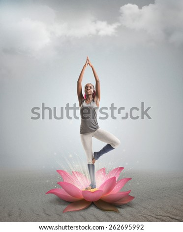 Young African woman in the stretching position in lotus flower - stock photo