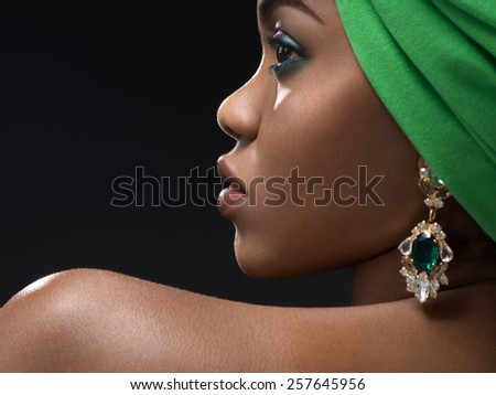 Young african woman in the studio - stock photo