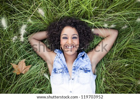 Young african woman relaxing in the park - stock photo