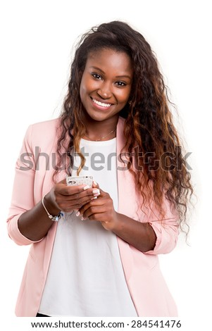 Young african woman sending a sms on her smartphone