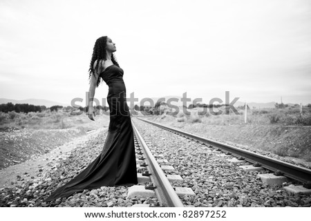 Young african woman with elegant black dress - stock photo