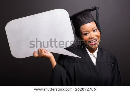young afro american graduate with blank text bubble isolated on black - stock photo