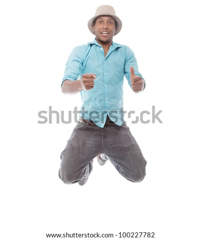 Young afro american man jumping over isolated white background. - stock photo