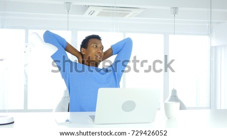 Young Afro-American Man Relaxing Body in Office