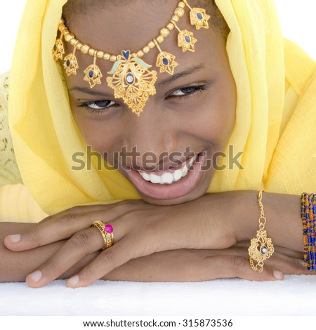 Young Afro beauty dressed for a celebration, isolated  - stock photo