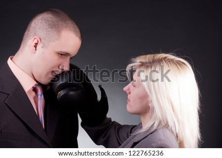 young agressive businesswoman hit businessman