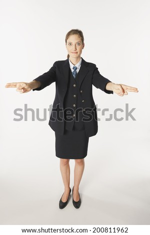 Young air hostess performing emergency instructions - stock photo