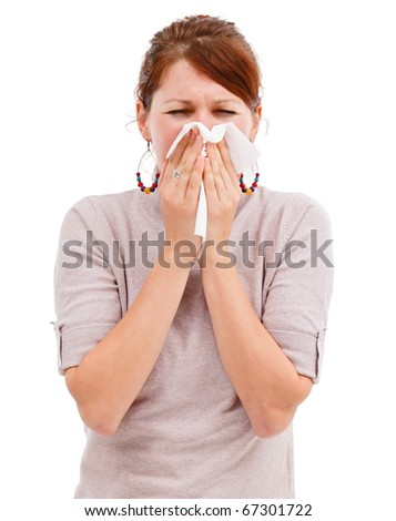Young allergic woman sneeze or blowing her nose - stock photo