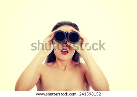Young amazed woman with binocular - stock photo