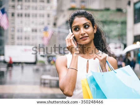 Young american woman making shopping in New york city - stock photo