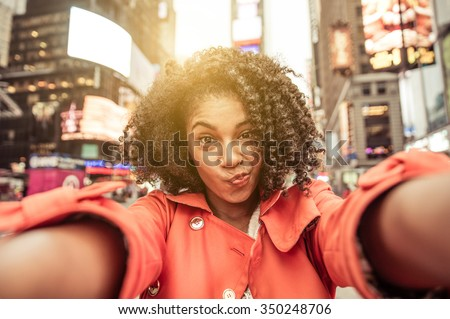 Young american woman taking selfie in New york, Time square - stock photo