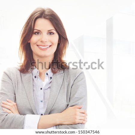 Young and attractive business woman in office - stock photo