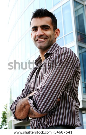 young and attractive businessman with smile - stock photo