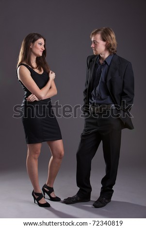 Young and attractive couple standing and flirting together
