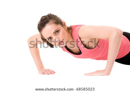 young and attractive female makes push-ups on white floor, studio shoot isolated on white - stock photo