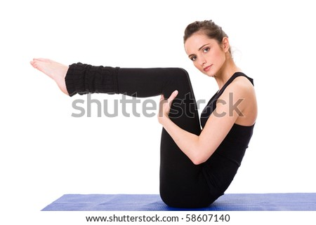 young and attractive female makes some exercises, blue mat, studio shoot isolated on white - stock photo