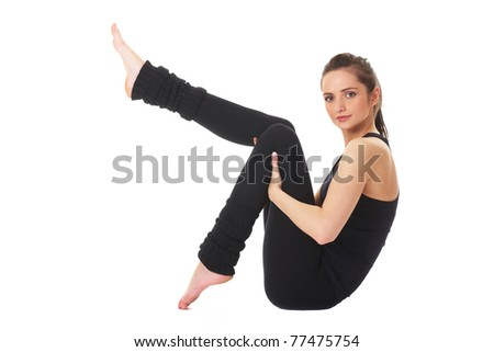 young and attractive female makes some exercises on white floor, studio shoot isolated on white - stock photo