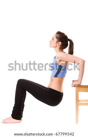 young and attractive female makes some exercises on white floor using chair, studio shoot isolated on white - stock photo