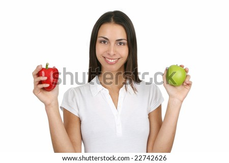 Young and attractive girl holding a red bell pepper and an apple. Isolated on white. - stock photo