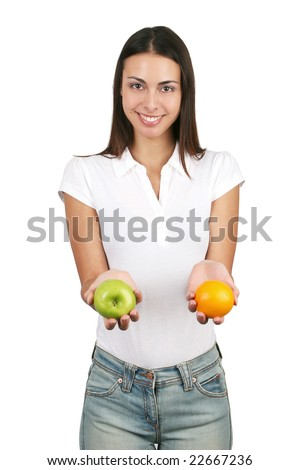 Young and attractive girl holding an apple and an orange. Isolated on white. - stock photo