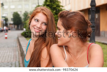 Young and attractive girlfriends have fun in street - stock photo