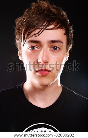 Young and attractive guy on black background - stock photo