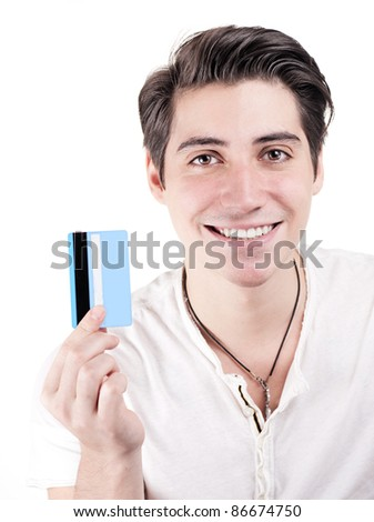 Young and attractive happy man holding credit card - stock photo