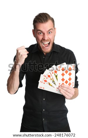Young and attractive man wearing a black shirt with his sleeves rolled up, holding a fan of a royal flush in diamonds on big sized cards. White background. - stock photo