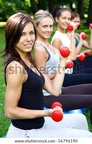 young and attractive people group doing fitness exercises - stock photo