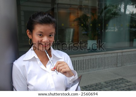 young and attractive student with white shirt and pen - stock photo