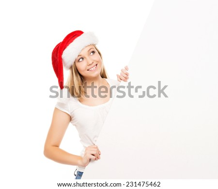 Young and attractive teenager girl with a blank billboard isolated on white background - stock photo