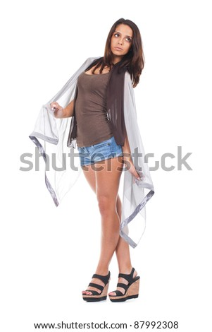 young and attractive woman posing wrapped in a grey scarf