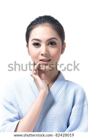 Young and beautiful asian woman touching her face - stock photo