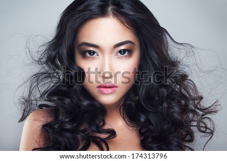 Young and beautiful asian woman with curly hair - stock photo
