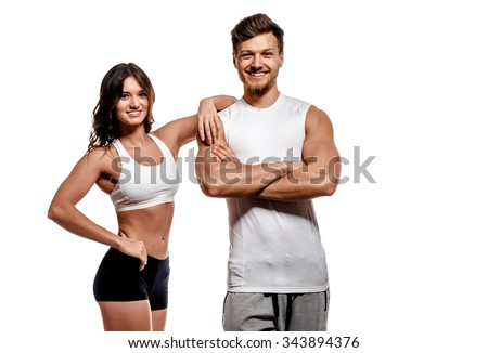 Young and beautiful athletic woman and man isolated on white background - stock photo