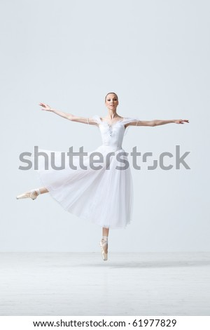 young and beautiful ballet dancer jumping - stock photo