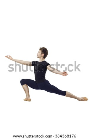 Young and beautiful ballet dancer performing complicated dance elements on a white background