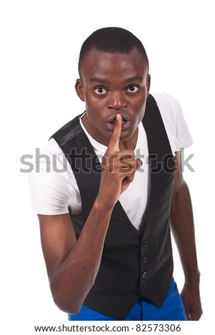 young and beautiful black man doing silence sign