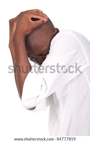 young and beautiful black man feeling afraid and scared - stock photo