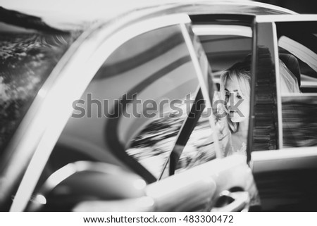 young and beautiful bride sitting in the car