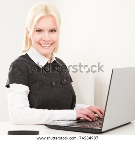 Young and beautiful business woman at work - stock photo