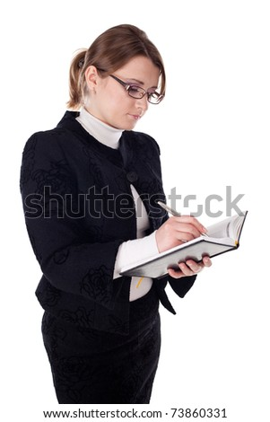 young and beautiful business woman while holding notepad