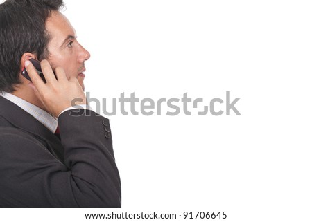 young and beautiful executive businessman making a call on his cellphone - stock photo