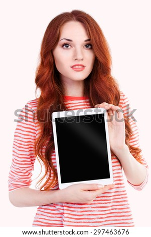 Young and beautiful female student holding digital tablet computer PC, smiling isolated on white background.  - stock photo