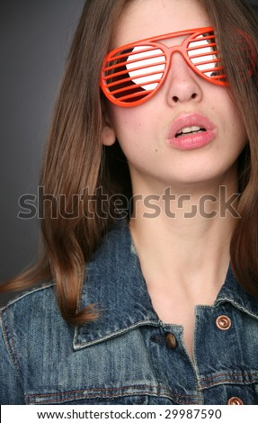 young and beautiful girl in the stylish red sunglasses - stock photo