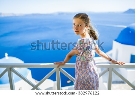 Young and beautiful girl, Santorini, Greece  - stock photo