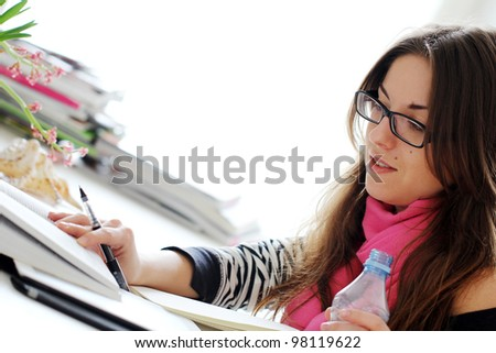 Young and Beautiful girl studying at home - stock photo