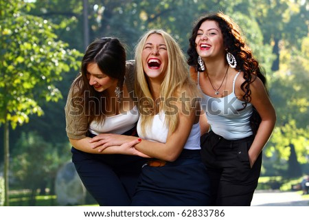 Young and beautiful girlfriends have some fun in park